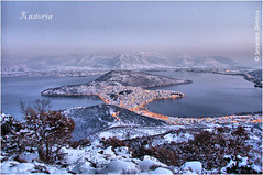 KASTORIA (D. Smixiotis) Tags: travel winter lake snow beautiful canon wonderful landscape greek photography photo view unique gorgeous magic great hellas greece macedonia excellent lovely marvelous magnificent splendid terrific wooz kastoria makedonia  macadonia ysplix canon40d    discoveryphotos canon1785456is