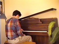 John at Piano