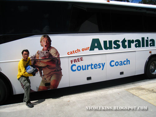 kif posing with steve irwin bus