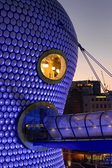 UK - Birmingham - Selfridges at dusk 02 (Darrell Godliman) Tags: city uk greatbritain travel bridge england urban copyright building travelling tourism architecture buildings arquitectura birmingham europe britishisles unitedkingdom britain dusk shoppingcentre icon selfridges departmentstore gb architektur modernarchitecture architettura citycentre floodlit bullring allrightsreserved architectuur brum midlands pedestrianbridge mimari futuresystems architecturalphotography contemporaryarchitecture travelphotography themidlands instantfave famousbuilding omot  travelphotographer selfridgesco flickrelite dgphotos darrellgodliman wwwdgphotoscouk architecturalphotographer dgodliman parametricbridge ukbirminghamselfridgesatdusk02