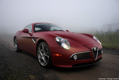 Alfa Romeo 8C... (Damian Morys Photography) Tags: light red sports wet grass car rain fog clouds canon dark lights coast italian mud head pennsylvania dirty east beam dirt exotic le alfa romeo belle 2009 supercar damian 18mm ditalia 8c macchine morys 40d