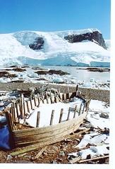 Wrecked whaling boat (chris.bryant) Tags: ocean wood sea sky sun snow ice boats ruins rocks afternoon antarctica cliffs shipwreck shore bow wreck 1001nights soe icebergs wmp floatingice 5photosaday bej abigfave platinumphoto ultimateshot flickraw