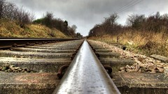 Line Of Sight HDR (Osgoldcross Photography) Tags: trees sky grass lines rain concrete grey glow moody shine perspective railway wires hdr westyorkshire pontefract banking ballast sleepers railtrack infastructure trackbed railbed northernrail 3xp photomatix handheldhdr streethouse