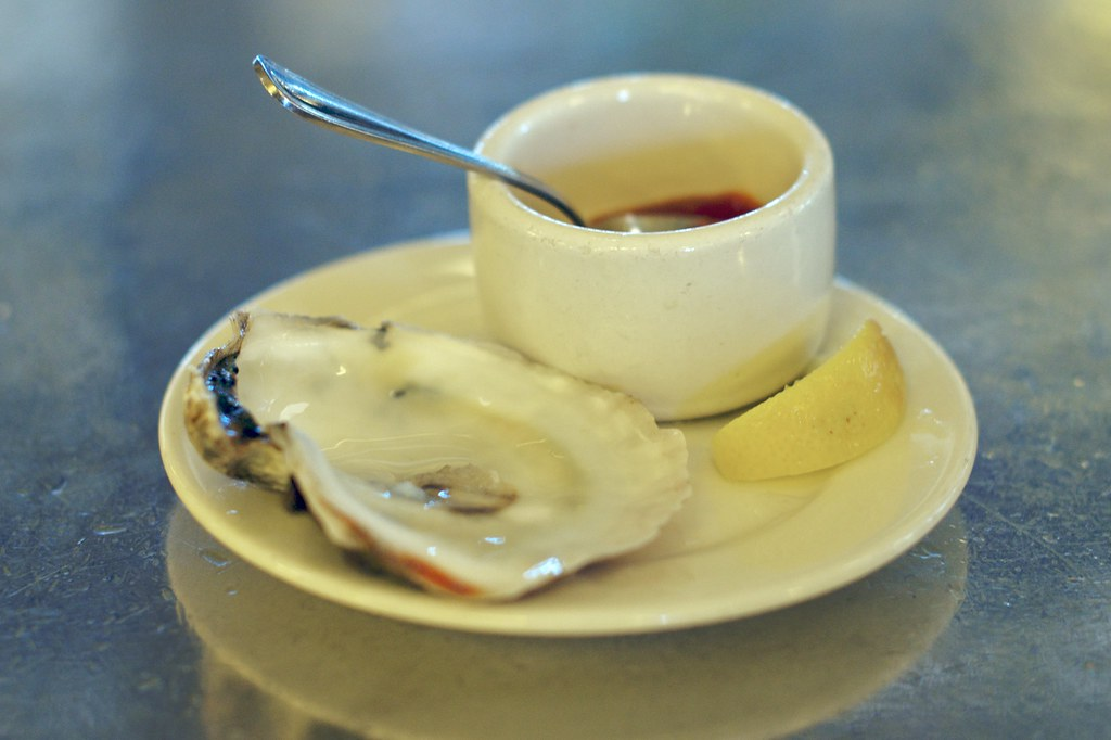 consumed oyster on the half shell