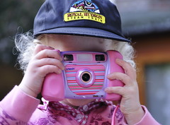 Mommy's favorite subject imitating mommy (Dirgnie) Tags: camera pink cute hat cap isabella 2009challenge 2009challenge112