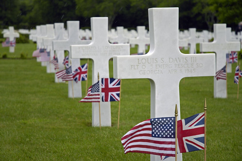 Flags decorate the graves of U.S. service members on Memorial Day at the Cambridge American Cemetery and Memorial in Madingley, England