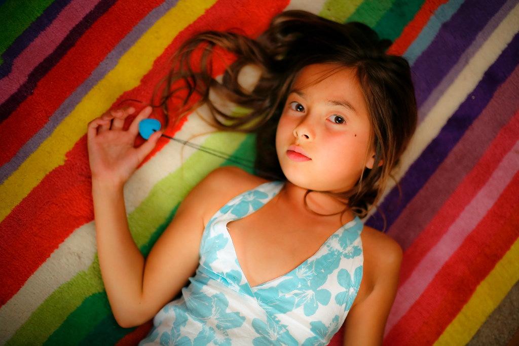Rainbow child: stuck for a backdrop? Use the carpet