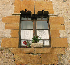 Gothic window (angelsgermain) Tags: flowers summer window stone village curtain gothic catalonia flowerpot column catalunya middleages monells baixempord flickrestrellas anticando