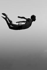 Cliff jumping in Santorini (Scott Norsworthy) Tags: bw cliff silhouette jump jumping mediterranean santorini greece leap 2470l oia freefall