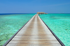 Welcome Home...! (muha...) Tags: travel blue winter sea summer sky people cloud reflection travelling tourism beach home water private island nikon walk jetty scenic lagoon tourist tropical welcome maldives pathway seahouse waterbungalow muha muhaphotoscom maldivestourism