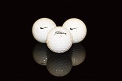 Golf Balls (natsimms) Tags: black reflection glass golf 50mm nikon nike titleist d80 abigfave beginnerdigitalphotographychallengewinner