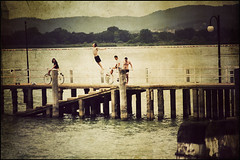 The dive in the lake (manlio_k) Tags: light people italy lake cinema boys water vintage movie dive moment cinematic vignetting