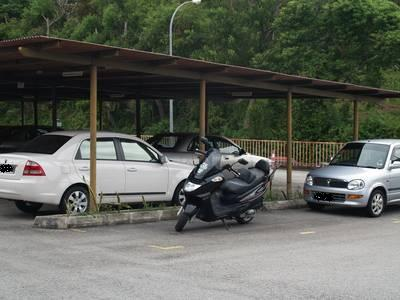 Motorcycle in car lot