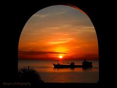 Sunrise at City of Naga, Cebu Amphitheater's arc (nlpapas (...returns)) Tags: soe abigfave platinumphoto diamondclassphotographer theunforgettablepictures goldstaraward rubyphotographer artofimages bestcaptureaoi
