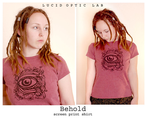 Behold silkscreen print on women's brick red shirt