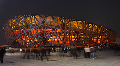 Iluminated... (flip.01) Tags: china longexposure travel light red people urban building architecture modern night moving nikon colorful raw stadium beijing menschen colourful olympic nikkor fx olympicstadium birdsnest jol 2470mm d700 2470mmf28g exposureeffect vipveryimportantphotos