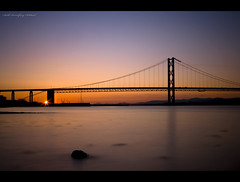 Tranquility (Chee Seong) Tags: uk longexposure sunset sun silhouette rock canon scotland edinburgh shore gradient firthofforth southqueensferry forthroadbridge canon2470mm 400d explore10 explorefrontpagethanks
