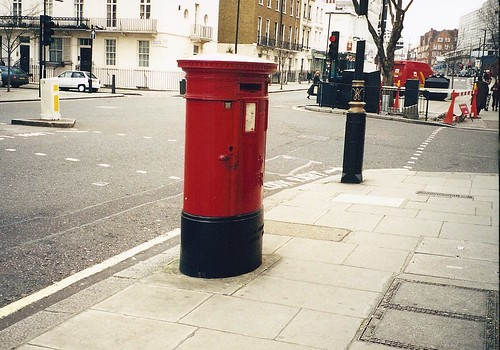 Stopping to send a post at the Mail Box on the streets of  London, England