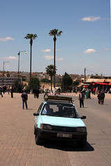 Little Blue Taxi (MykReeve) Tags: trees sky tree car taxi palmtrees morocco palmtree meknes placeelhedime petittaxi