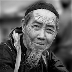 A Father figure (NaPix -- (Time out)) Tags: portrait bw man black 6x6 face canon square asia father vietnam explore emotions sapa hmong 500x500 explored napix canoneosdigitalrebelxsi winner500 eyesarethewindowstoyoursoul nonverbalconversations