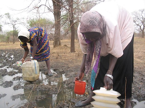 Before the wells were drilled, women were forced to scoop muddy water