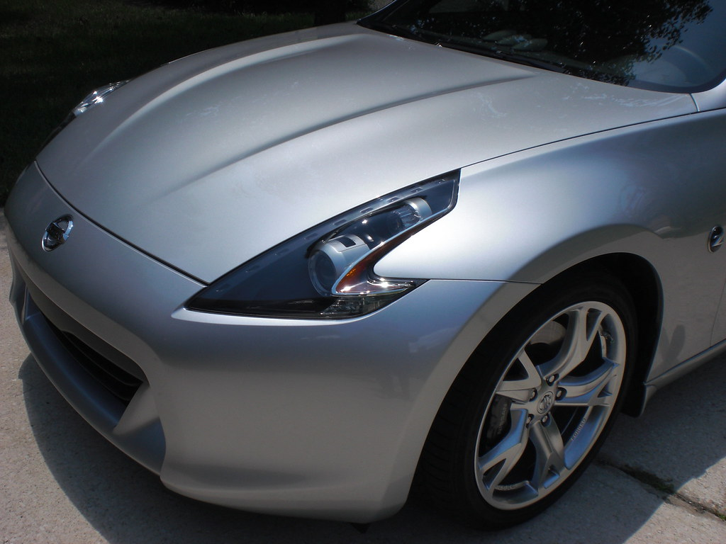 Black Headlight Housings On Brilliant Silver Nissan 370z
