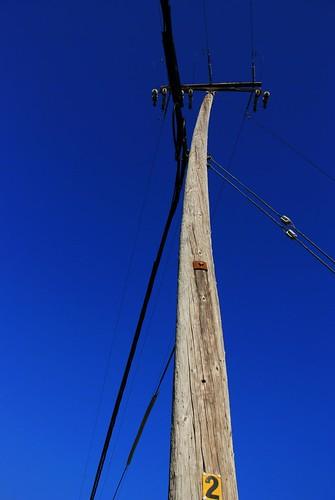blue wooden electricpost เสาไฟฟ้า