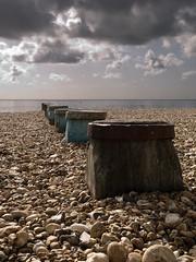 out to sea (slabrador) Tags: uk sea summer england beach clouds sussex stones shingle eastbourne southcoast groyne eastsussex englishchannel tidebreak 1260mmf2840 zuiko1260mm zuiko1260mmedf2840swd
