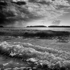 Cyclonic (ecstaticist) Tags: blackandwhite bw cloud white holiday canada storm black beach monochrome rain vancouver warning island sand whitewater long surf bc pacific wind wave monochromatic columbia explore wash tofino translucent british approach frontpage thunder approaching raincloud impending tonkin