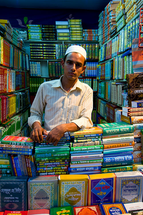 Bookseller outside a mosque in Dhaka, Bangladesh
