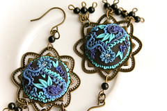jungle beauty earrings (Chili Crab) Tags: flowers blue black one chili crystal handmade ooak earring crab jewelry kind fimo clay etsy brass 2009 onyx filigree polymer swarovsky