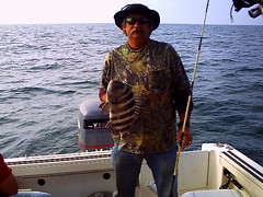 FISHING  3-19-09 (crazydude713) Tags: ocean summer sun fish water kids sunrise fun fishing pond bass bigfish firstkiss sunsetdolpine