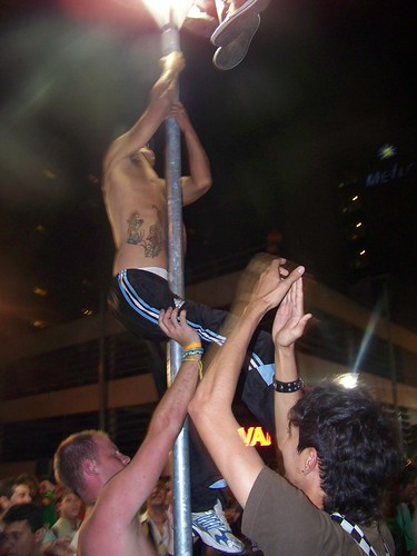 Climbing a lamp post in Buenos Aires on St Patrick's Day