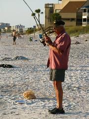 Fisherman (Krista Rehbein Photography) Tags: fish beach stpetersburg fishing fisherman sand florida dusk cigar captain