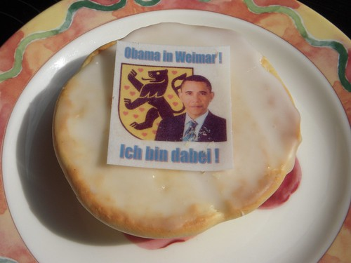 This baked good/cookie, in German, is an Amerikaner.  The German language Wikipedia Article links to an English article calling it a Black & White Cookie.  Obama will be here in just over a week!