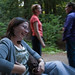 Jennifer (Nichols) Baird (L, sitting), wife of Robert Baird (not shown) who is Sandy Baird's brother.  Background, friend and event photographer Cortney (orange shirt) talking to Sandy (blue, standing).