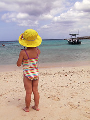 *~*sigh*~* (citygirlny10305) Tags: ocean vacation cute beach water girl beautiful hat clouds swimming boat sand toddler waves stripes horizon goggles tan adorable footprints curacao barefeet backside bathingsuit godteam