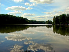 Partly cloudy (bdaryle) Tags: blue trees lake nature water clouds reflections outdoors sony silhouettes canoes boathouse biglake umsteadstatepark reflectsobsessions brandondaryle bdaryle imagesbybrandon