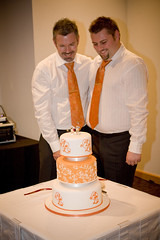 Cake cutting 4 (Alistair & Liam) Tags: gay wedding orange cake weddingcake first cutting caketopper forheavenscake alistairliam almotiff swaroskicyrstals