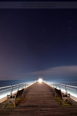 Infinity and beyond (~Glen B~) Tags: saltburn pier night bench benches wooden boardwalk railings torch lights sea cloud sky north northern vanishing point infinity beyond stars startrails longexposure