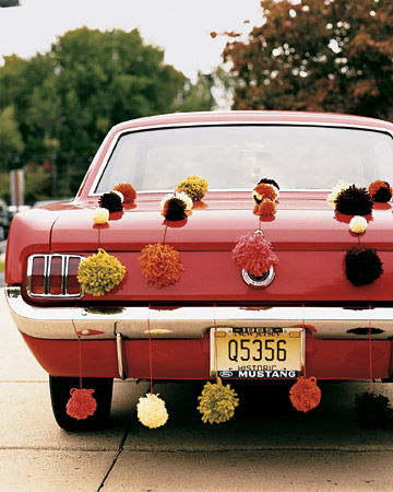 handmade pompoms on getaway car, marthastewartweddings