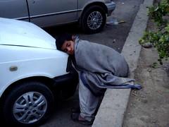 Care-charming Sleep, thou easer of all woes, (tango 48) Tags: pakistan boy white car sleep slumber company karachi islamabad chador karachicompany