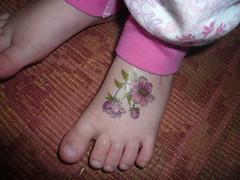 tattoos (thirteensparrows) Tags: flower tattoo fiona 4yrs