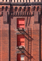Red Brick Fire Escape (luv nature) Tags: building brick architecture fire shadows fireescape ladder exit fireexit fireladder pilasters brickpilasters
