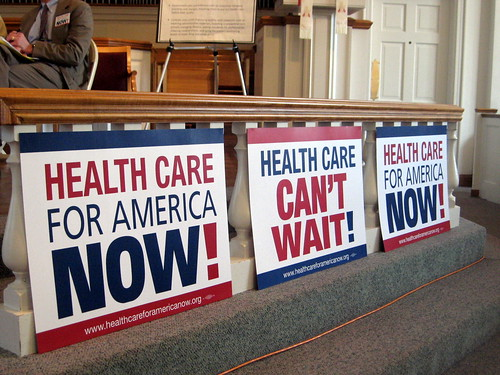 signs urging health care for america now