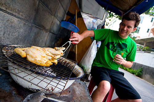 Hock grilling Portuguese-style chicken on the streets of BKK