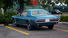 Rear-left side angle of a 1968 Mercury Cougar. (Steve Brandon) Tags: auto plaza ontario canada ford car geotagged 60s parkinglot classiccar automobile mercury ottawa voiture suburb 1960s 1968 nepean cougar  coupe sixties musclecar stripmall sportscar 68 ponycar stationnement  americancar mercurycougar       fordmotorcompany  merivaleroad  merivalerd  merivalemarket ruemerivale cheminmerivale
