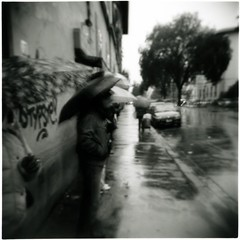 Rain and Tears (ale2000) Tags: street winter people urban blackandwhite bw white black wet rain umbrella mediumformat square geotagged florence blackwhite holga strada gente candid best bn rainy photowalk firenze 1968 urbanjungle vignetting inverno pioggia bianco nero francobattiato biancoenero quelli ilfordfp4 demisroussos ombrelli bagnato rainandtears unusualseasons aphroditeschild aledigangicom cronacheurbane mraphroditeschild lacrimeepioggia bestoftheyear2009 geo:lat=4378835 geo:lon=11249206