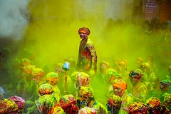 Last Man Standing ( Poras Chaudhary) Tags: people india man colors yellow festival standing colorful crowd holi