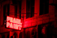 Pearl Paint Hellscape (Lindsay Beyerstein) Tags: street city nyc newyork reflection window sign night dark canal paint neon outdoor manhattan fireescape pearl pearlpaint